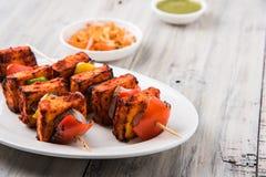 Indian paneer barbecue or tikka kabab. Paneer Tikka Kabab - Tandoori Indian cheese skewers, malai paneer tikka / malai paneer kabab, chilli paneer served in Stock Images