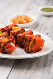 Indian paneer barbecue or tikka kabab. Paneer Tikka Kabab - Tandoori Indian cheese skewers, malai paneer tikka / malai paneer kabab, chilli paneer served in Stock Photo