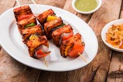 Indian paneer barbecue or tikka kabab. Paneer Tikka Kabab - Tandoori Indian cheese skewers, malai paneer tikka / malai paneer kabab, chilli paneer served in Royalty Free Stock Photography