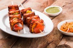 Indian paneer barbecue or tikka kabab. Paneer Tikka Kabab - Tandoori Indian cheese skewers, malai paneer tikka / malai paneer kabab, chilli paneer served in Royalty Free Stock Image
