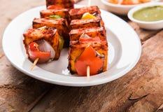 Indian paneer barbecue or tikka kabab. Paneer Tikka Kabab - Tandoori Indian cheese skewers, malai paneer tikka / malai paneer kabab, chilli paneer served in Royalty Free Stock Photo