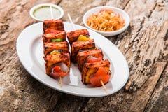 Indian paneer barbecue or tikka kabab. Paneer Tikka Kabab - Tandoori Indian cheese skewers, malai paneer tikka / malai paneer kabab, chilli paneer served in Stock Photos