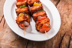 Indian paneer barbecue or tikka kabab. Paneer Tikka Kabab - Tandoori Indian cheese skewers, malai paneer tikka / malai paneer kabab, chilli paneer served in Royalty Free Stock Photos