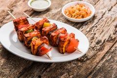 Indian paneer barbecue or tikka kabab. Paneer Tikka Kabab - Tandoori Indian cheese skewers, malai paneer tikka / malai paneer kabab, chilli paneer served in Stock Image