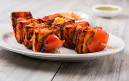 Indian paneer barbecue or tikka. Paneer Tikka Kabab - Tandoori Indian cheese skewers, malai paneer tikka / malai paneer kabab, chilli paneer served in white Royalty Free Stock Photos