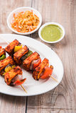Indian paneer barbecue or tikka. Paneer Tikka Kabab - Tandoori Indian cheese skewers, malai paneer tikka / malai paneer kabab, chilli paneer served in white Royalty Free Stock Photo