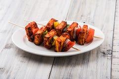Indian paneer barbecue or tikka. Paneer Tikka Kabab - Tandoori Indian cheese skewers, malai paneer tikka / malai paneer kabab, chilli paneer served in white Stock Photography