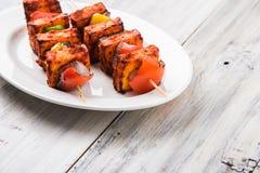 Indian paneer barbecue or tikka. Paneer Tikka Kabab - Tandoori Indian cheese skewers, malai paneer tikka / malai paneer kabab, chilli paneer served in white Stock Image