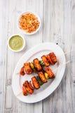 Indian paneer barbecue or tikka. Paneer Tikka Kabab - Tandoori Indian cheese skewers, malai paneer tikka / malai paneer kabab, chilli paneer served in white Royalty Free Stock Image