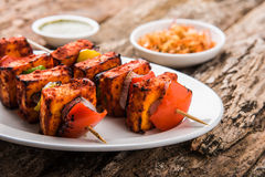 Indian paneer tikka or barbecue cheese cottage. Paneer Tikka Kabab - Tandoori Indian cheese skewers, malai paneer tikka / malai paneer kabab, chilli paneer Royalty Free Stock Photo