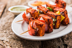 Indian paneer tikka or barbecue cheese cottage. Paneer Tikka Kabab - Tandoori Indian cheese skewers, malai paneer tikka / malai paneer kabab, chilli paneer Stock Photos