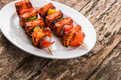 Indian paneer tikka or barbecue cheese cottage. Paneer Tikka Kabab - Tandoori Indian cheese skewers, malai paneer tikka / malai paneer kabab, chilli paneer Stock Photography