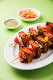 Indian paneer tikka or barbecue cheese cottage. Paneer Tikka Kabab - Tandoori Indian cheese skewers, malai paneer tikka / malai paneer kabab, chilli paneer Stock Photo