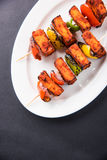 Indian paneer tikka or barbecue cheese cottage. Paneer Tikka Kabab - Tandoori Indian cheese skewers, malai paneer tikka / malai paneer kabab, chilli paneer Royalty Free Stock Photos