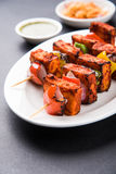 Indian paneer tikka or barbecue cheese cottage. Paneer Tikka Kabab - Tandoori Indian cheese skewers, malai paneer tikka / malai paneer kabab, chilli paneer Royalty Free Stock Images