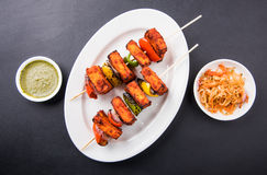 Indian paneer tikka or barbecue cheese cottage. Paneer Tikka Kabab - Tandoori Indian cheese skewers, malai paneer tikka / malai paneer kabab, chilli paneer Stock Image
