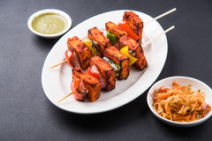 Indian paneer tikka or barbecue cheese cottage. Paneer Tikka Kabab - Tandoori Indian cheese skewers, malai paneer tikka / malai paneer kabab, chilli paneer Royalty Free Stock Photography