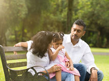 Indian parent dealing with daughter Royalty Free Stock Photo