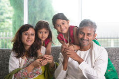 Indian parents and children. Happy Indian family at home. Asian parents with their kids, sitting on sofa. Parents and children indoor lifestyle royalty free stock image
