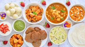 Indian party platter. Indian vegetarian platter consisting of sweets ,yogurt, curries,dosa Stock Image