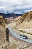 Indian passenger bus on highway in Himalayas. Ladakh, India. Indian passenger bus on NH-1 (Srinagar Leh national highway) in Himalayas. Ladakh, India Stock Photography