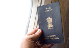 Indian Passport in hand Stock Photo