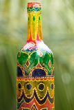 Indian pattern on bottle. Decorative glass bottle is painted and decorated with rhinestones Stock Photos