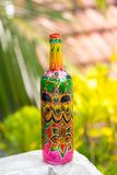 Indian pattern with flower. Decorative glass bottle is painted and decorated with rhinestones Stock Photography