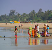 Indian people on the beach at Gokarna Royalty Free Stock Images