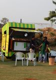 Indian people buy street food at food trucks stationed in open area Royalty Free Stock Image