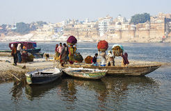 Indian people crossing the Ganges river. In the moning Stock Image