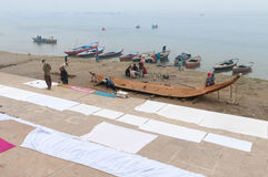 Indian people make boat on ghat near sacred river Ganges in Varanasi Stock Photography