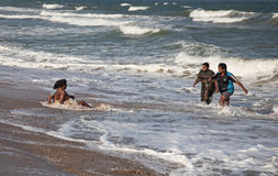 Indian people in the ocean Stock Images