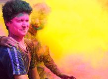 Indian People playing with colorful gulal on Holi. Two boys in the fog of colors/ gulal during Holi celebration in India Royalty Free Stock Photos