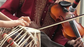Indian people playing Indian music on Violin and Tabla Punjabi drums stock footage
