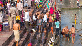 Indian people at ritual washing in the sacred Ganges river. Haridwar , India Stock Photography