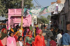 Indian people walking in the street of Pushkar Stock Photo