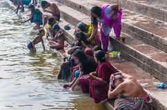 Indian people wash themselves in the river Ganges Royalty Free Stock Photography