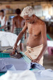 Indian people working hard on Dhobi Ghat in Fort Cochin, India Stock Photos