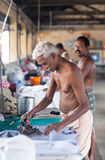 Indian people working hard on Dhobi Ghat in Fort Cochin, India Royalty Free Stock Photo