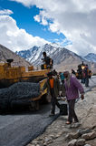 Indian people working at road construction Stock Photo