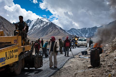 Indian people working at road construction Stock Images