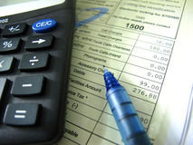 Indian Phone Bill. A calculator with monthly phone bill and pen Royalty Free Stock Image