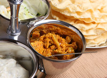 Indian Pickles & Poppadoms. Lime pickle with raita, onion salad and poppadoms Royalty Free Stock Image