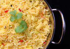 Indian Pilau rice. In a stainless steel serving dish Stock Image