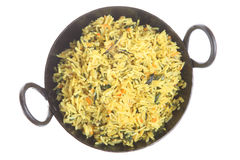 Indian Pilau Rice. Pilau rice with spinach and carrots in an authentic korai dish Royalty Free Stock Image