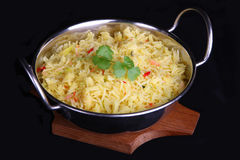 Indian Pilau Rice. Pilau rice in an authetic koria serving dish Stock Photography
