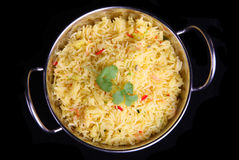 Indian Pilau rice. In a stainless steel serving dish Stock Photography