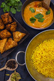 Indian pilau rice in balti dish served with chicken tikka masala Stock Photography