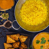 Indian pilau rice in balti dish served with chicken tikka masala Royalty Free Stock Image
